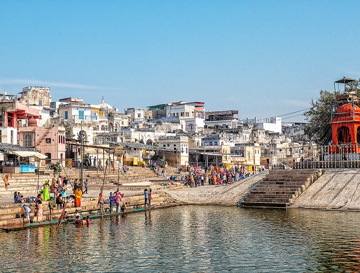 Pushkar Lake is goal of the pilgrims coming to cleanse their sins. The small town Pushkar Mela Rajasthan surrounds it, and the ghats, or steps, lead the pilgrims down into the water.