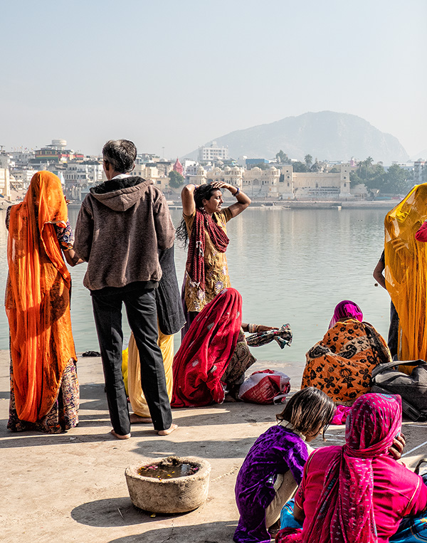 Here women are drying off and getting dressed again after they have bathed in the sacred waters. The colours of India are vibrant and captivating. - Pushkar Fair