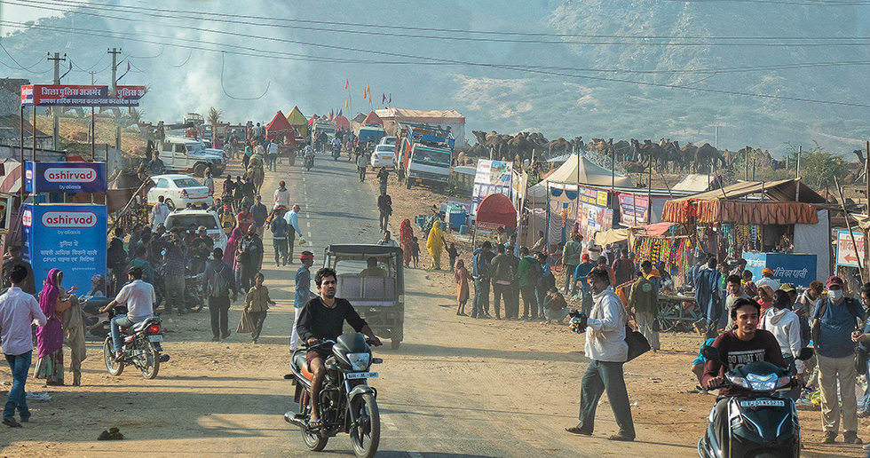 The camel camps (one is at upper right) are spread around this Pushkar Camel Festival street where many temporary market stalls offer take-out food, camel décor, pots and pans, and much more for the traders and their families.