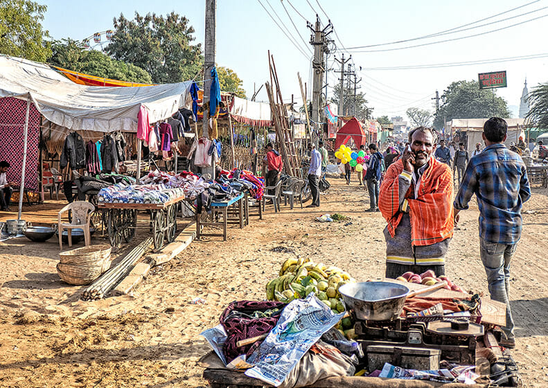As I walk along the street into town, a street vendor heads to the Pushkar Fair camps to sell his wares about 9:00am. The stalls are also temporary here; later the crowds get crazy.