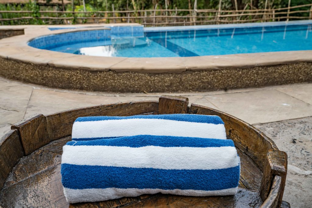Beach Towels with pool in the background at Kings Lodge in Madhya Pradesh