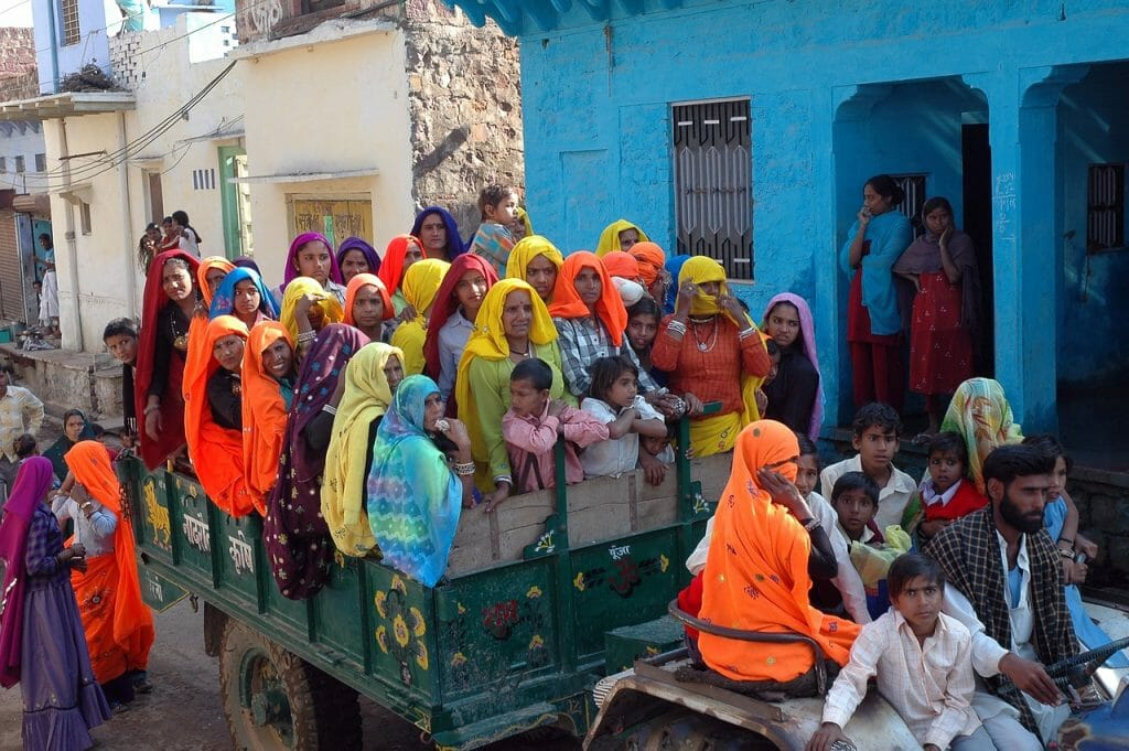 Indian Women in Colorful Saris Riding on a Cart