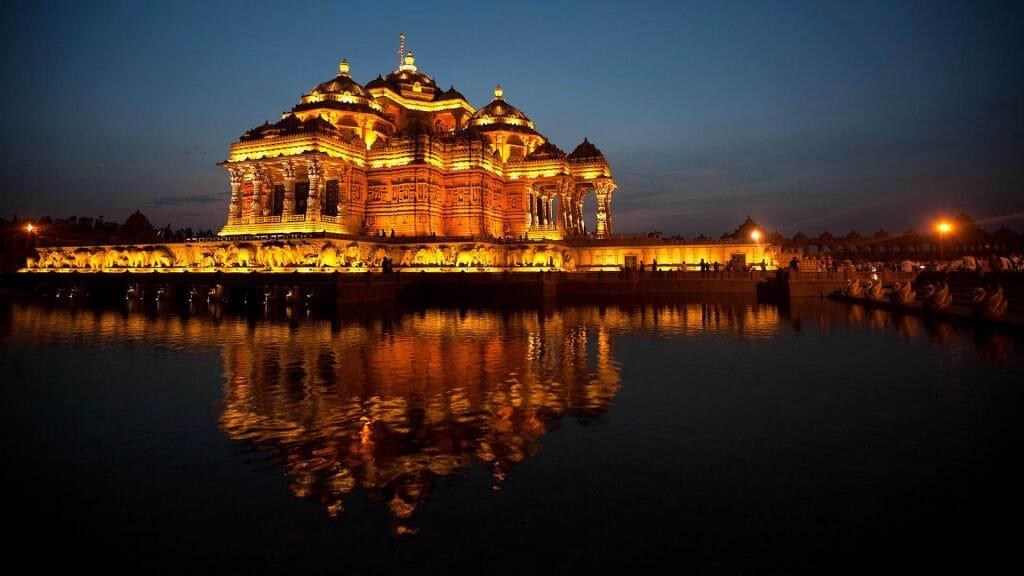 Akshardham Temple Delhi evening lighting reflected across the water
