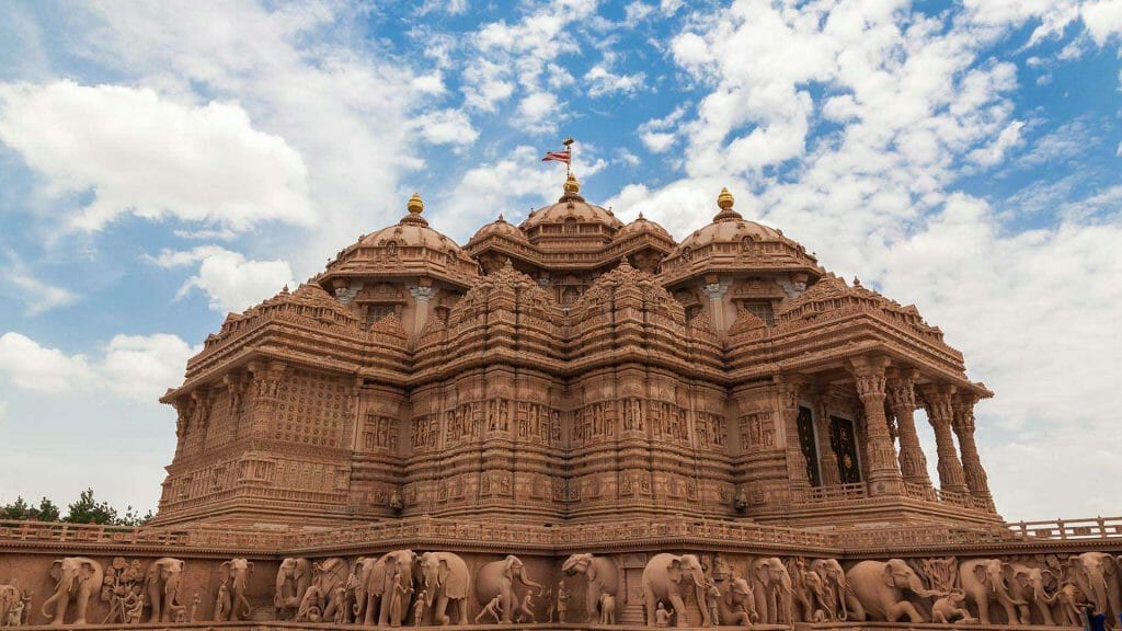 Akshardham Mandir from a side angle with the stone elephants below