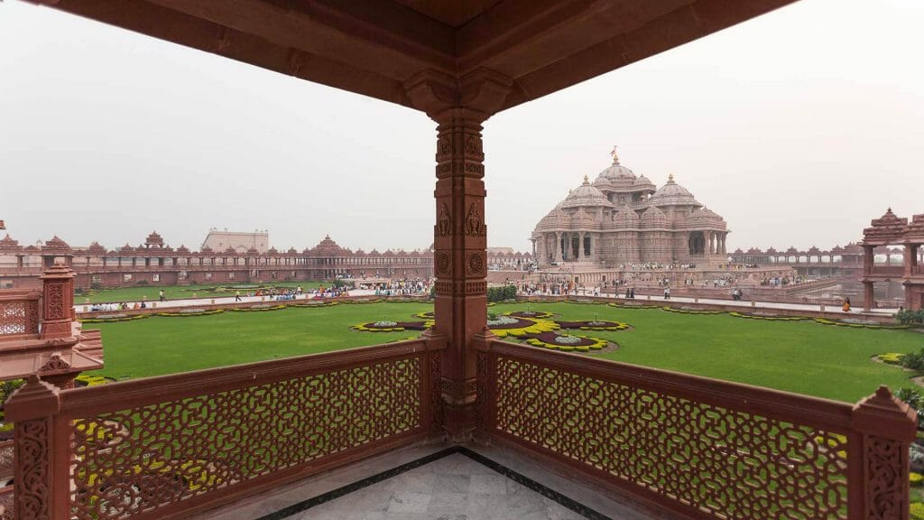 Akshardham Temple Delhi in the distance with a view of the garden in for foreground