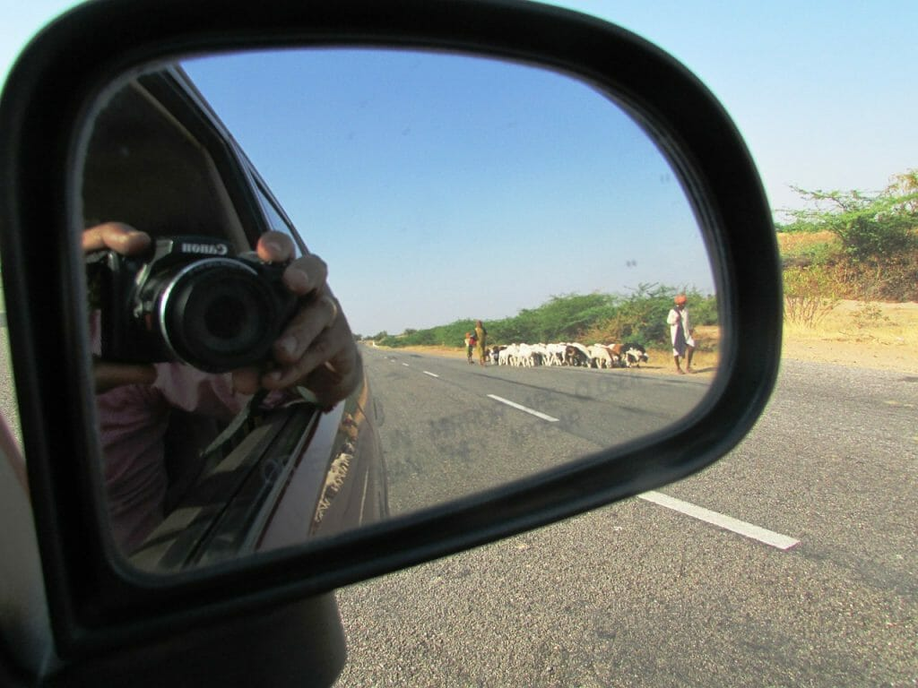 Photo of Camera in car side mirror on Indian Road