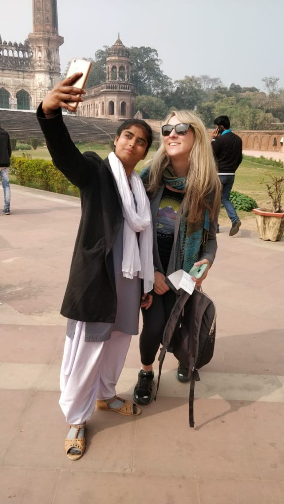 Indian woman taking a selfie with a blonde white woman on a bright day